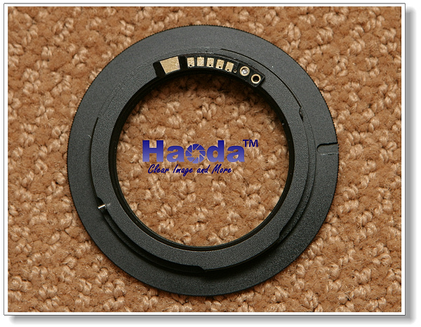 Haoda M-42 to Canon EOS electronic mount adapter with autofocus confirmation.